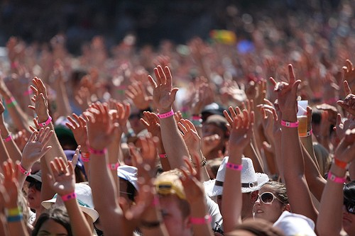 A crowd with their hands raised