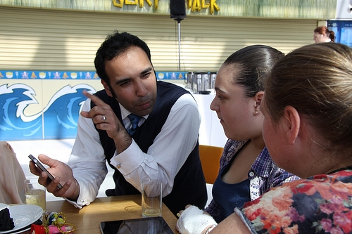 Dr Shaibal Roy talks with patients at Evelina Children's Hospital