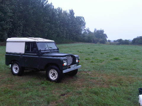 The Land Rover in a field